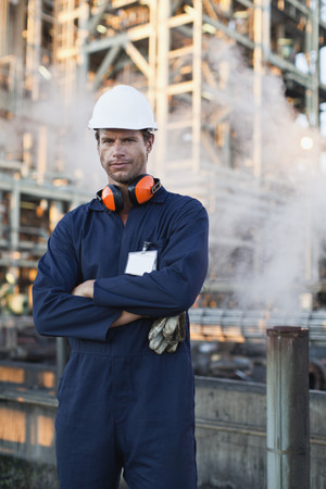 Worker standing at oil refinery