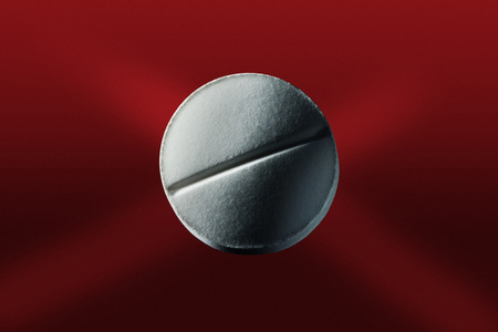 dependencies: Close up of pill on red surface