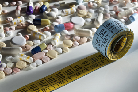 cures: Scattered pills and measuring tape