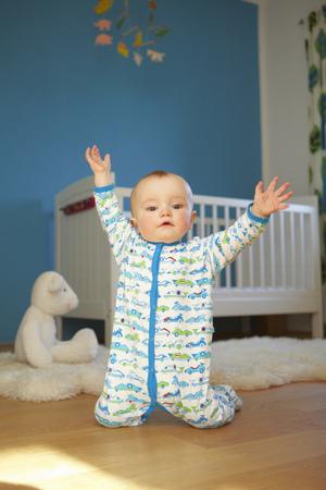 Toddler playing on nursery floor