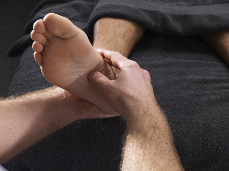massage homme: Close up of man having foot massage