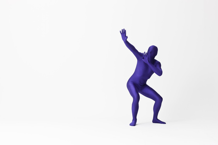 Man in bodysuit posing