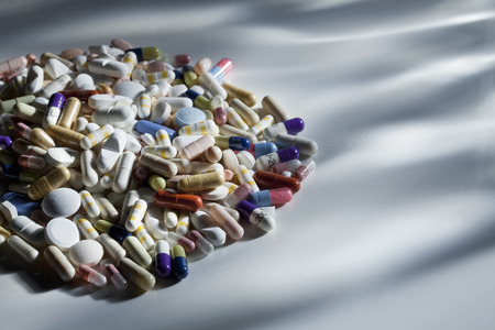 cures: Close up of pile of assorted pills LANG_EVOIMAGES