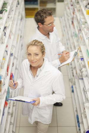 resolving: Pharmacists browsing medicines on shelf