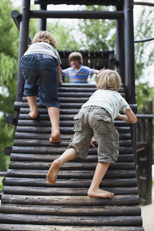 scaling: Boys playing on play structure together