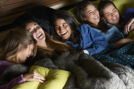 shared sharing: Women watching television together