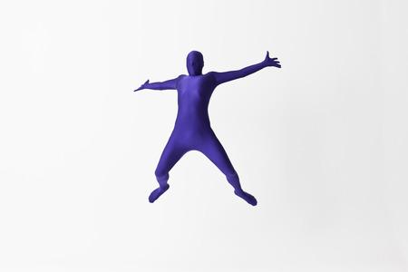 Man in bodysuit jumping for joy