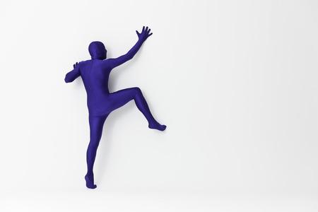 purples: Man in bodysuit scaling wall