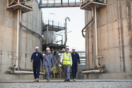 under control: Workers walking at chemical plant