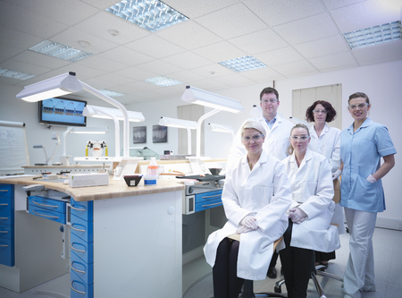 Dentist and dental students in lab