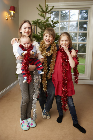 spirited: Children playing with Christmas tinsel
