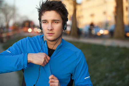 fastened: Runner listening to headphones outdoors