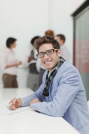conferring: Businessman making notes in meeting