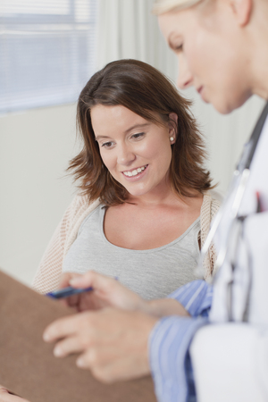 Doctor and patient talking in office LANG_EVOIMAGES