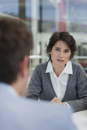 consulted: Business people talking in meeting
