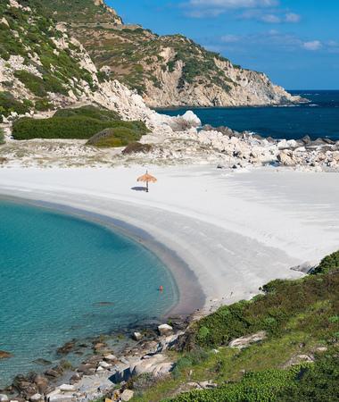 seascapes: Umbrella on deserted tropical beach
