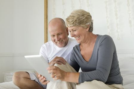 shared sharing: Older couple using tablet computer
