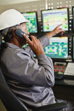 responding: Man working in security control room LANG_EVOIMAGES