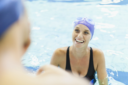 safe water: Swimmers talking in pool LANG_EVOIMAGES