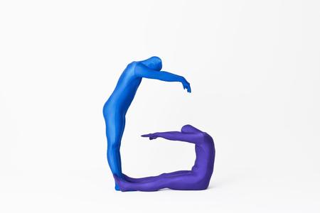 Men in bodysuits making the letter G