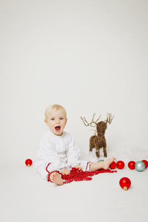 mischeif: Baby girl holding Christmas ornaments