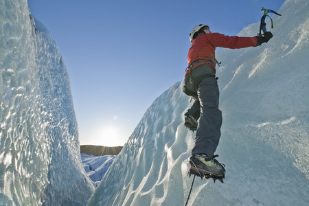 snowed: Climber scaling glacier wall