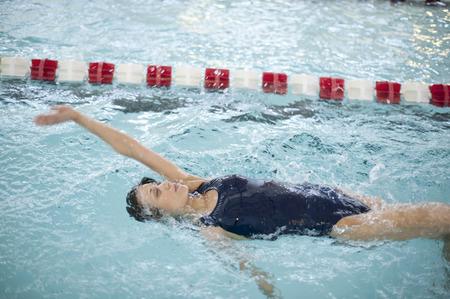 Woman doing laps in swimming pool