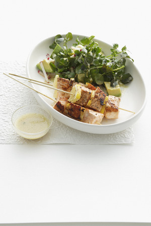 tempted: Plate of salmon skewers and salad