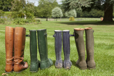 Pairs of boots standing in field LANG_EVOIMAGES
