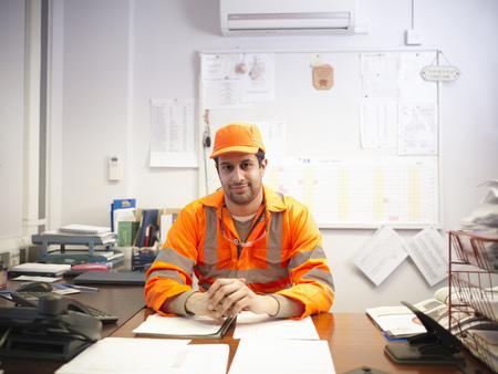 teaches: Apprentice engineer at office desk
