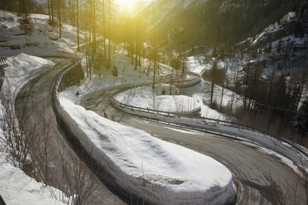 Winding road in snowy landscape