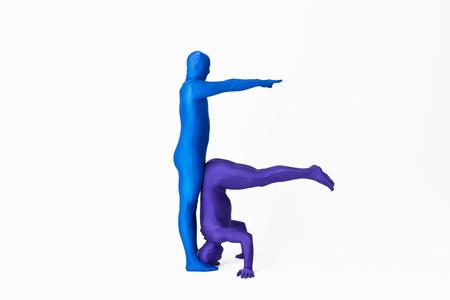 limber: Men in bodysuits making the letter F