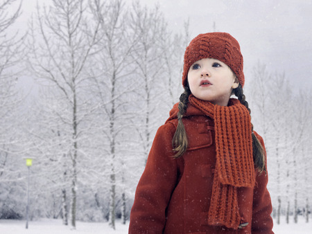 Girl walking in snow LANG_EVOIMAGES