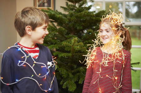 spiritual beings: Children playing with Christmas lights