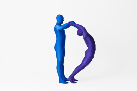 purples: Men in bodysuits making the letter D