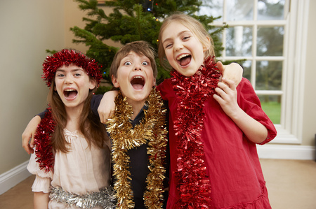 spiritual beings: Children playing with Christmas tinsel