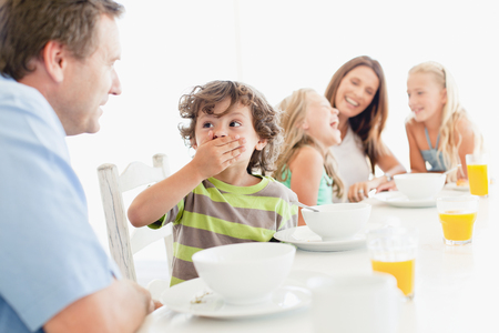 feasting: Family talking at breakfast table