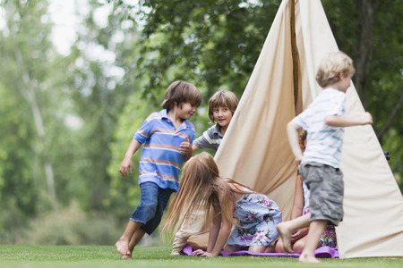 Children playing in tent outdoors