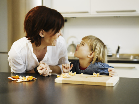 help section: Mother and daughter peeling orange
