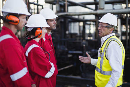 resolving: Workers talking at chemical plant