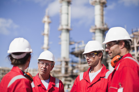 resolved: Workers talking at oil refinery LANG_EVOIMAGES