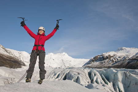 spirited: Climber cheering on top of glacier