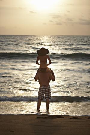 wade: Man carrying girlfriend on shoulders