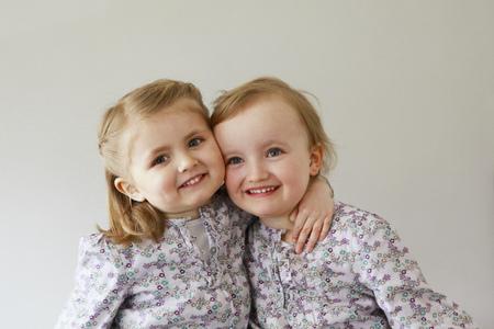 equivalents: Girl toddlers smiling together LANG_EVOIMAGES