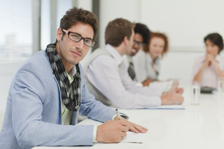 consulted: Businessman making notes in meeting