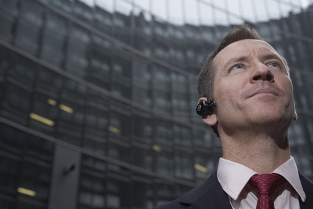 hands free device: Businessman wearing headset outdoors