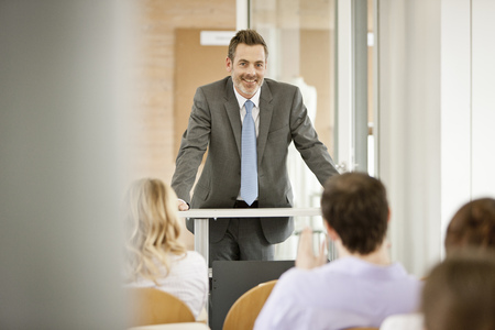 new age: Businessman hosting seminar in office