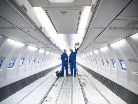 2 50: Worker examining empty airplane