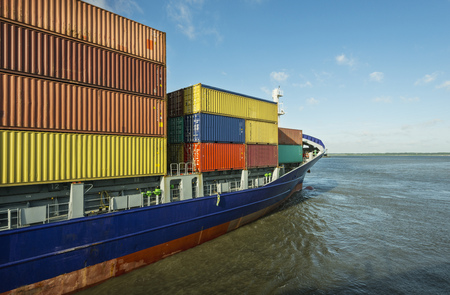 Container ship sailing into harbor LANG_EVOIMAGES