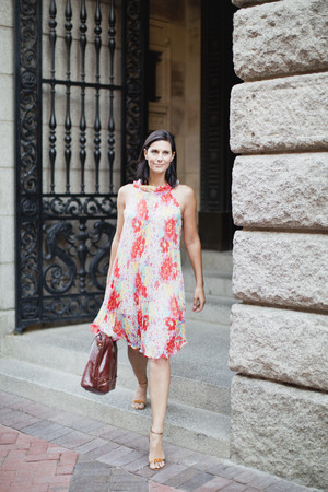 admired: Smiling woman walking on city street